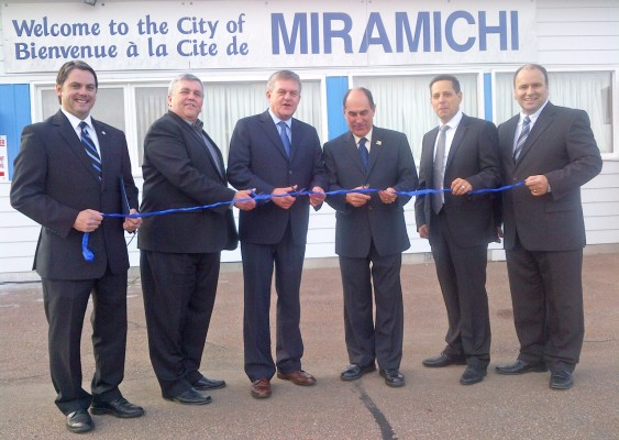 Southwest Miramichi MLA Jake Stewart; Public Safety Minister and Solicitor General Robert Trevors; Premier David Alward; Gerry Cormier, Mayor of Miramichi; Thomas Linkletter, chair of the Miramichi Airport Commission; and Miramichi Bay-Neguac MLA Serge Robichaud.